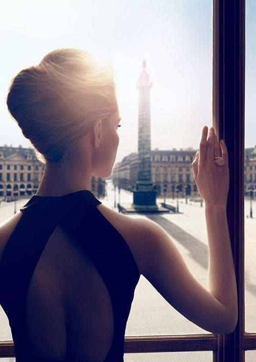 as she gazes out the window, she transcends off into her own dream world and likes what she see's. beautiful