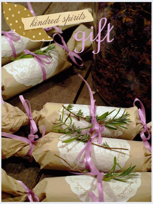 wrapped in pretty tissue, doilies, lavender ribbon and tucked in a sprig of lavender