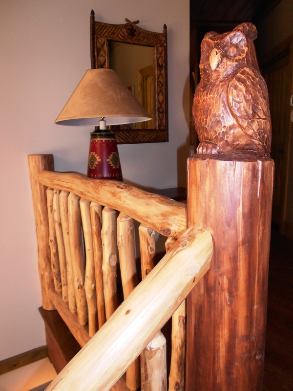 This owl overlooks the balcony and accompanies our locust interior railings.