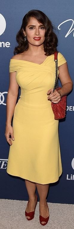 Who made Salma Hayek's yellow pleated dress and red woven clutch handbag?