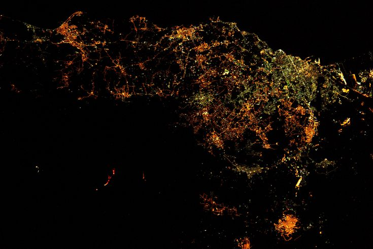 """Space Station View of Mount Etna Erupting The Expedition 50 crew aboard the International Space Station had a nighttime view from orbit of Europe's most active volcano Mount Etna erupting on March 19 2017. Astronaut Thomas Pesquet of ESA captured this image writing """"Mount Etna in Sicily. The volcano is currently erupting and the molten ava is visible from space at night!"""" March 22 2017"""