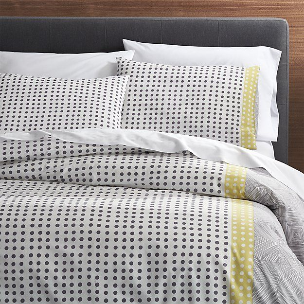 Shop Torben Yellow Duvet Covers and Pillow Shams.  Loving the immediacy and irregularity of hand-drawn designs, Genevieve Bennett has created a stunning motif of fine lines and playful dots just for us in a fresh palette of grey and yellow on white cotton.