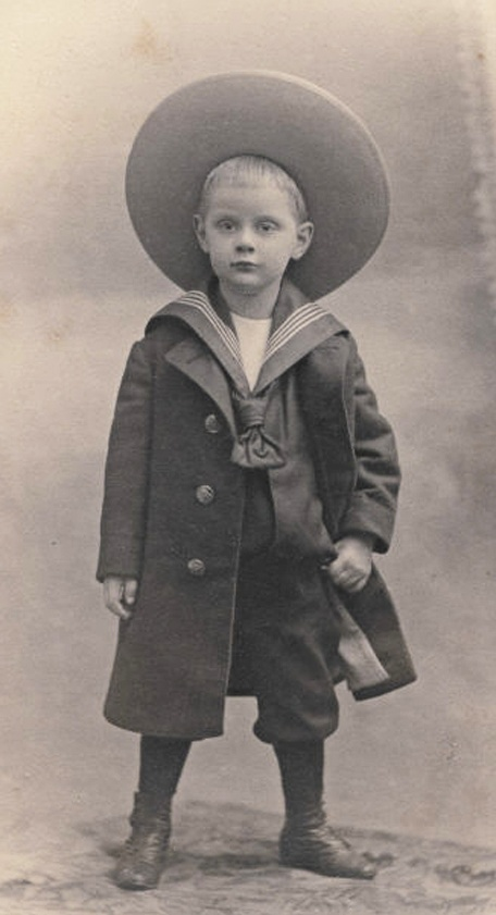 Young boy in his sailor suit and big sun hat.  Circa 1905.