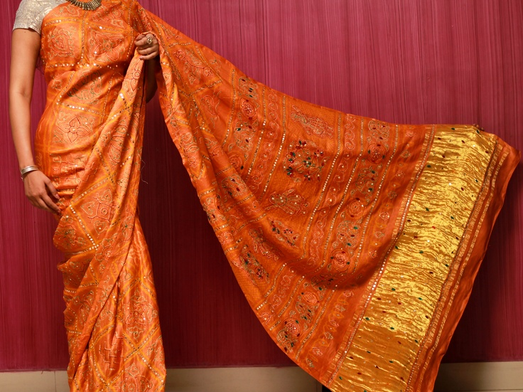 $ 150    Bandhej satin silk saree with Kadi border- the patterns on the saree are done with rice grains, extremely minute and perfect. 12 different motifs at that. EXCLUSIVE !!  Hand work all over the saree with mirrors, kundans and sequins..absolute decandent richness and royalty!