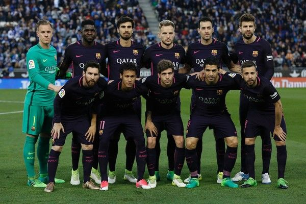 (FromL) Barcelona's players: (front row) German goalkeeper Marc-Andre Ter Stegen, French defender Samuel Umtiti, Portuguese midfielder Andre Gomes, Croatian midfielder Ivan Rakitic, midfielder Sergio Busquets, defender Gerard Pique and (front row) Argentinian forward Lionel Messi, Brazilian forward Neymar, midfielder Sergi Roberto, Uruguayan forward Luis Suarez and defender Jordi Alba pose before the Spanish league football match RCD Espanyol vs FC Barcelona at the Cornella-El Prat stadium…
