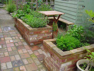 raised garden brick pathway | Reclaimed brick raised beds.