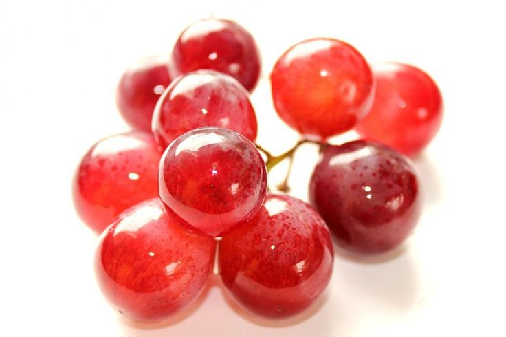Free image of Red Globe grapes isolated on white background