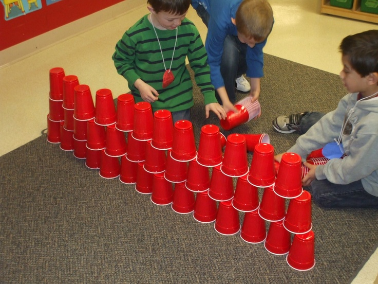 cup stacking with 100 cups on the 100th day of school- my idea- work on motor skills using these cups! This would be a great practice for those kids who grip hard.