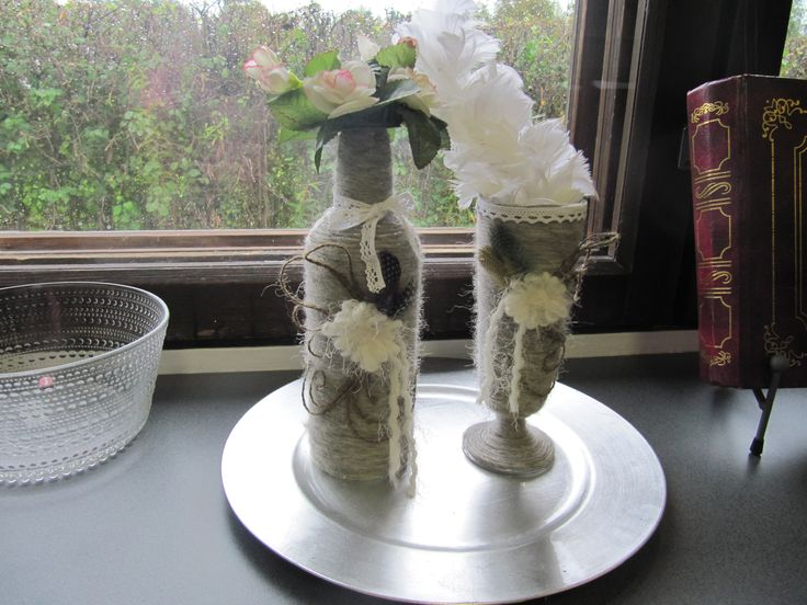 Bottle and glass covered with wool yarn. Diy home decor