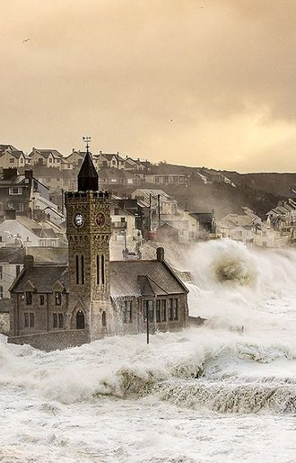 The clock tower in Porthleven, Cornwall, UK being battered by storm waves. February 2014 - Carla Regler