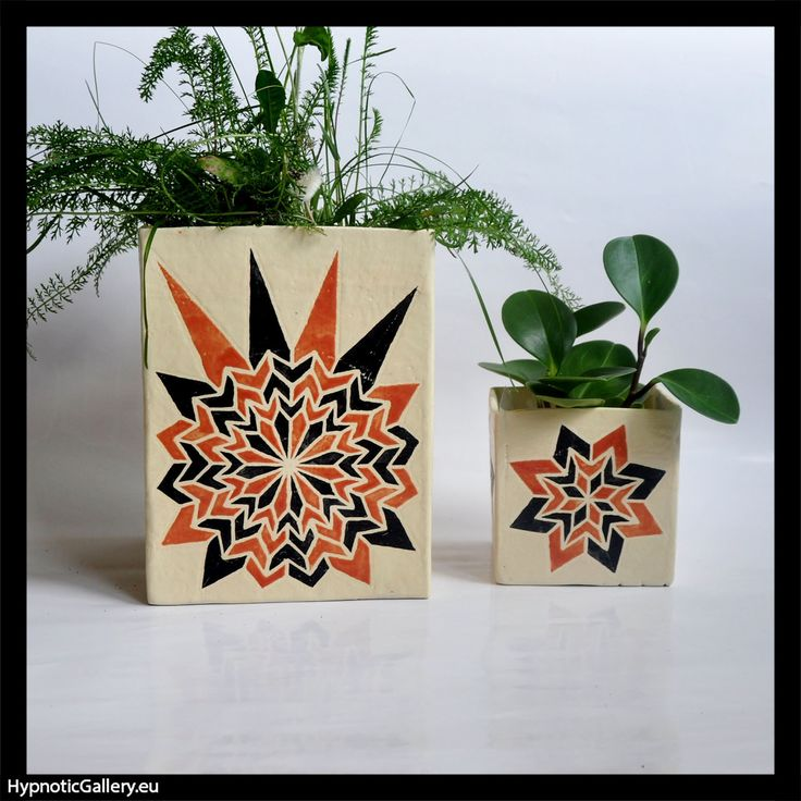 Planters parallelograms with geometric contrasting patterns.