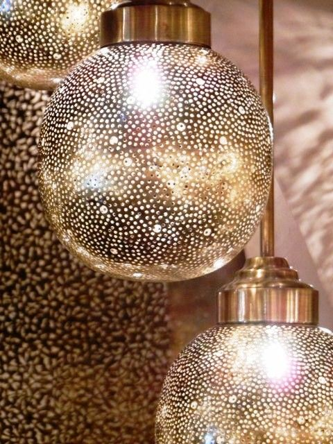 Moroccan ceiling light covered with finely hammered holes. Moroccan Decorating