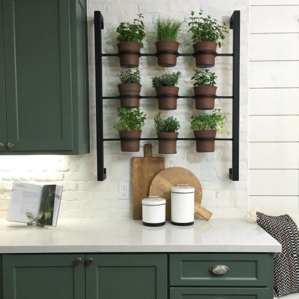 Hanging Herb Garden - Genius Kitchen Storage Ideas We're Stealing from Fixer Upper - Southernliving. This is our newest obsession. Joanna's idea for a kitchen herb garden couldn't be more convenient. It's mounted on the wall to keep countertops free for all that chopping, prepping, and biscuit cutting.