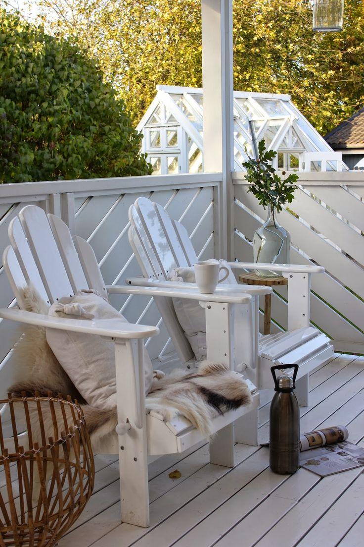 painted white Muskoka chairs