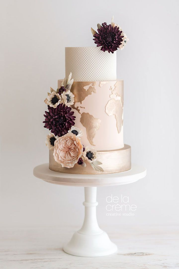 Main wedding cake with map of the world on center tier and David Austin roses, anemones and dahlias by De la Créme Creative Studio