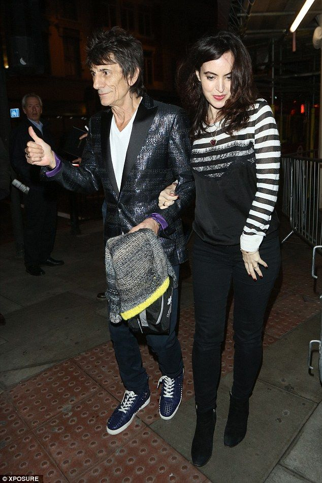 Bumping along nicely: On Wednesday night, Ronnie Wood and his pregnant wife Sally stepped out in public together for the first time since they made the announcement that they are expecting twins