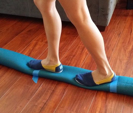 roll up a yoga mat to create a balance beam