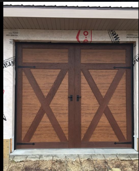 17 best images about clopay faux wood garage doors on for Composite wood garage doors