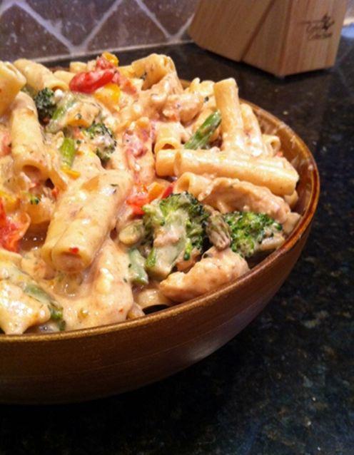 Confetti Chicken Pasta Recipe...yum creamy sauce made with feta, light cream and milk.