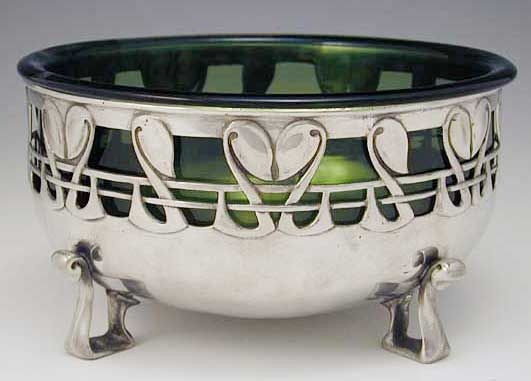 Archibald Knox (1864-1933) - For Liberty & Co. - Bowl with Liner. Pewter with James Powell of Whitefriars,  Green Glass Liner. England. Circa 1905.