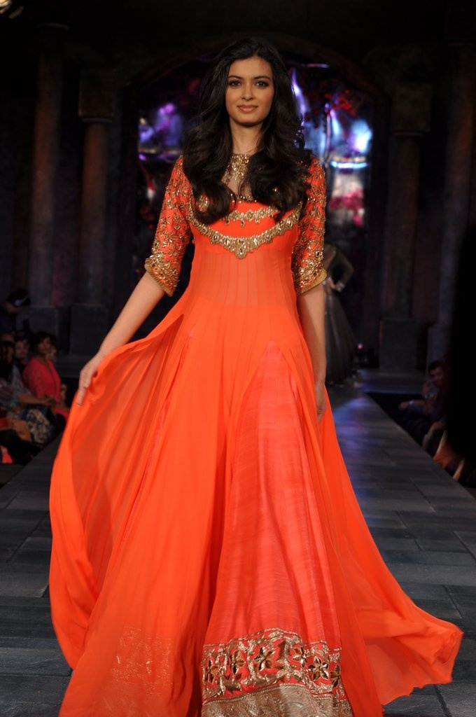 Diana Penty in an Indian outfit by Manish Malhotra. Love the color! // lengha sari saree salwar