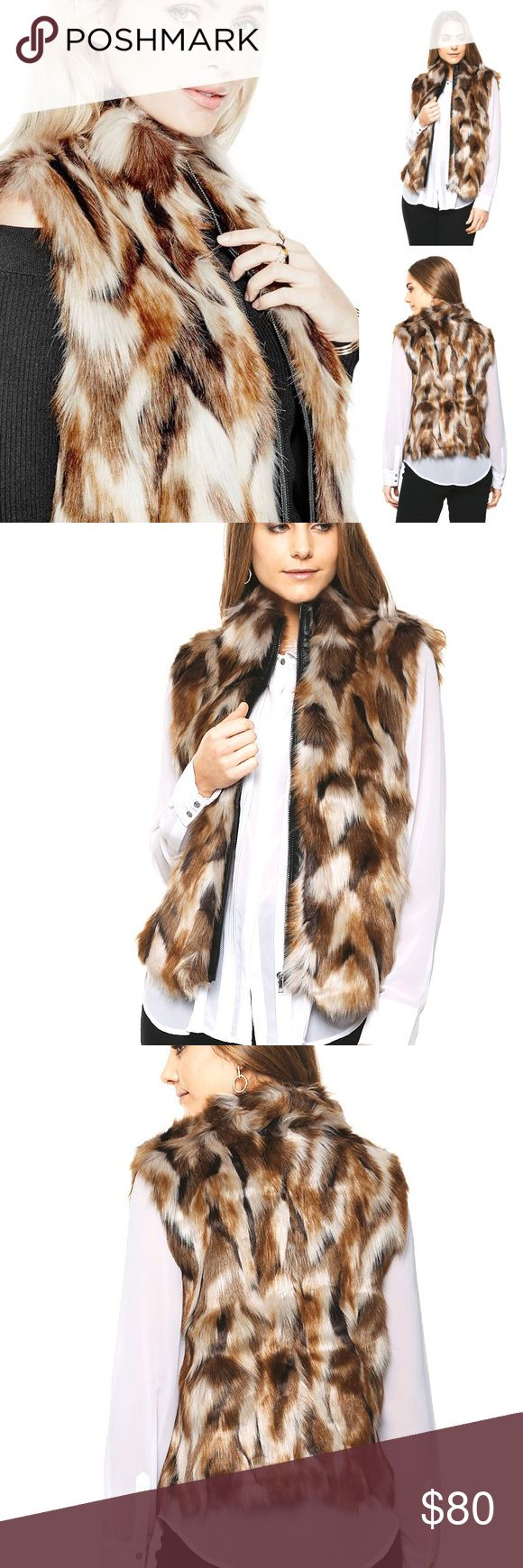 NWT Guess LA Kielo Faux Fur Vest ⭐️⭐️Next Day Ship⭐️New With Tags⭐️⭐️ FREE SHIPPING on bundles $50➕ Multicolor faux-fur vest with stand collar and faux-leather front placket. Zipper closure.  Shell: 80% Acrylic, 20% Modacrylic. Lining: 100% Polyester. Dry clean Color Camel Multi Guess Jackets & Coats Vests
