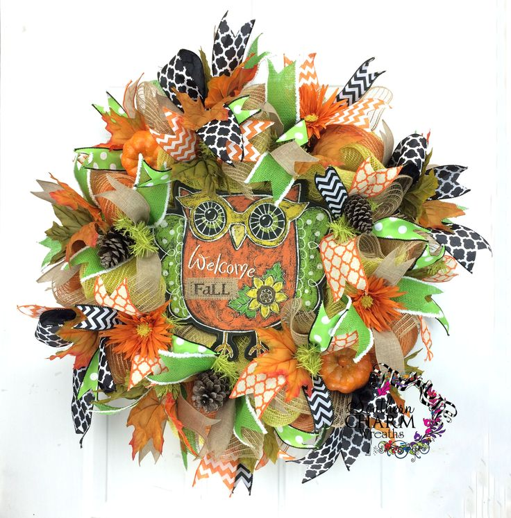 This bright and cheery fall deco mesh wreath with owl sign in the colors of yellow, orange and lime green will brighten up your doorway this fall. This fall wreath will look gorgeous on your front door or hanging in your home and is made with faux burlap mesh and a faux chalkboard owl sign. Design by www.southerncharmwreaths.com