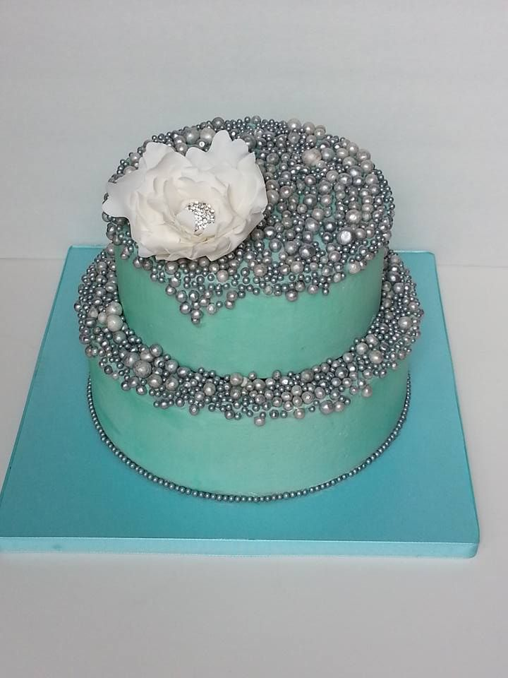 "A birthday cake for a sweet 12 yr old girl - inspired by The Butter End cake - silver pearls, pool blue, jeweled flower -visit me on fb @ ""ihateveggies cakes"""