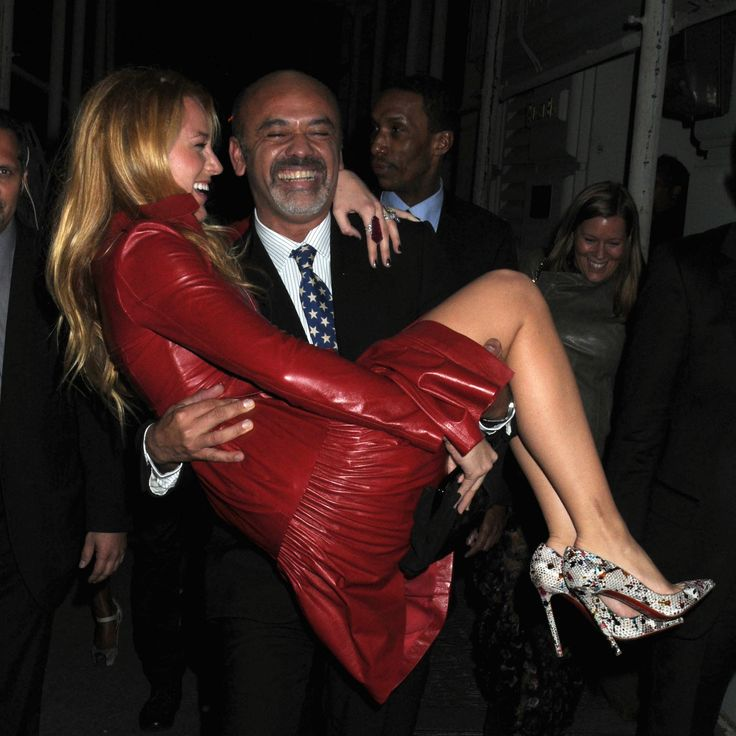 Blake Lively casually being carried away by Christian Louboutin.