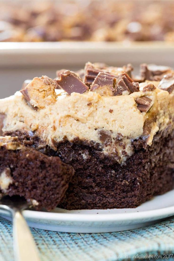 Peanut Butter Cup Poke Cake - an easy dessert recipe loaded with chocolate, peanut butter, and Reese's!