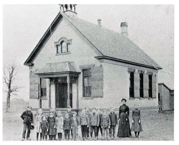 The picture of the school on the mural is the old school house in District No. 2 was organized in 1856. The Board and residents built the school which was the second one built in Anoka County