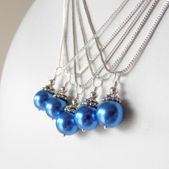 Horizon blue bridesmaid necklaces made with bright blue glass pearls topped off with antiqued silver layered beads and a tiny silver round bead.