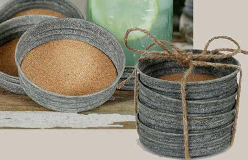 old mason jar lids lined with cork. =  rustic coasters..:)