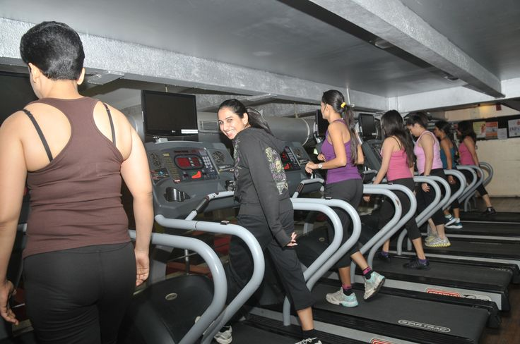 Beauties working out on a treadmill to win the contest of Ms. Fit & Fab. Year 2011 At Gold's Gym Bandra.