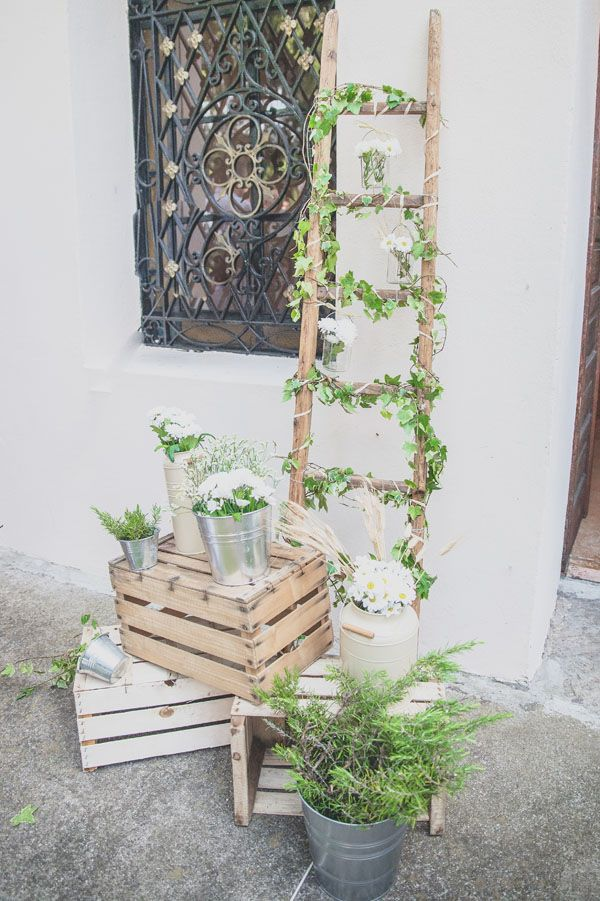 country wedding decor with wooden crates and vintage ladder
