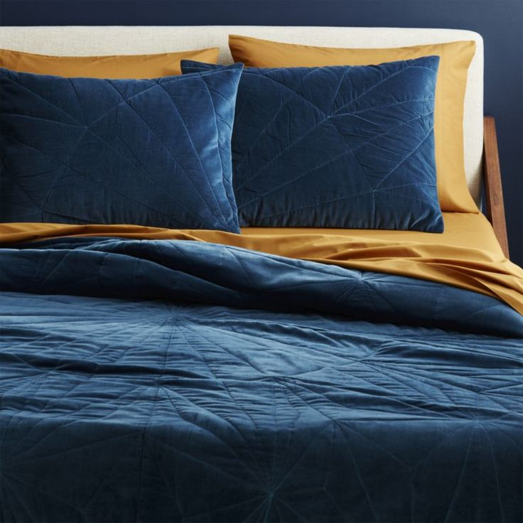 Shop vail navy velvet full/queen quilt.   Hand-stitched, extra-plush velvet makes a lounge-worthy bed in a deconstructed snowflake pattern designed for CB2 by Bryn E.  Namavari.