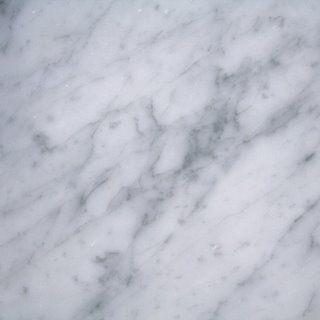 supreme white granite; river white granite; carrara white granite....more durable than carrara marble in kitchen and bathrooms?