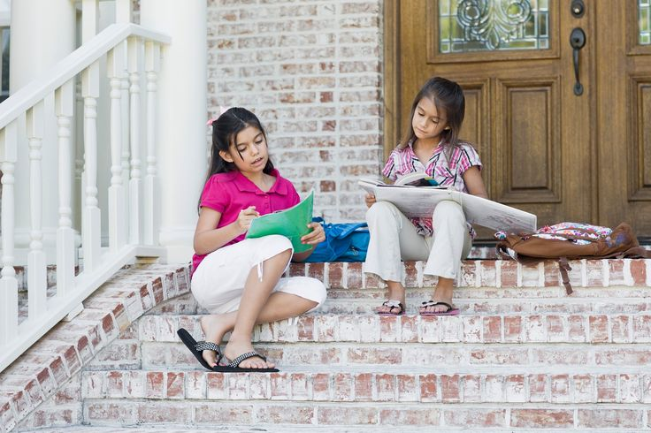 Girls doing Homework on Steps - 600-04625353 © Kevin Dodge Model Release: Yes Property Release: No  Girls doing Homework on Steps