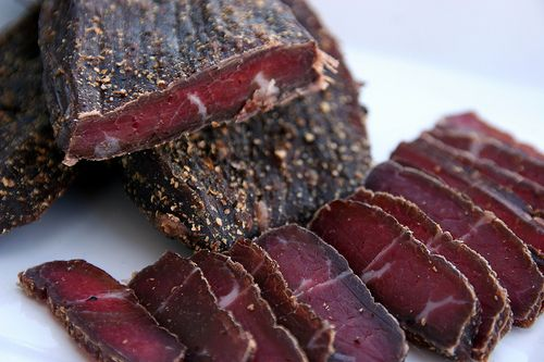 Biltong -- savory, delicious, South African beef jerky.  The best place to get this if you are in the Los Angeles area IMO is European Deluxe Sausage Kitchen on Olympic in Beverly Hills.  If you love beef jerky, their biltong is the money.  :-)