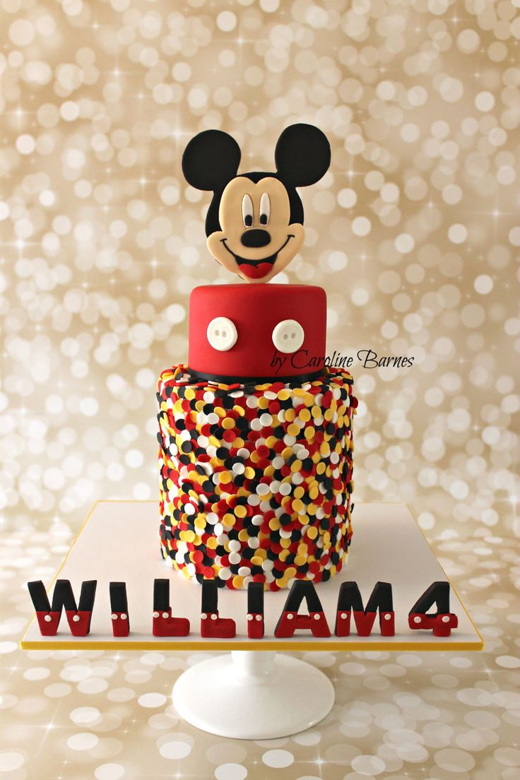 Mickey Mouse cake with edible confetti and 2D topper.