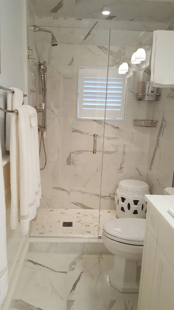 Budget Blinds of The Hamptons, Huntington, and Port Jefferson offers unique and beautiful window treatments for any room in your home! These WATERPROOF shutters look exactly like wood, and complete the clean, minimalist look in this bathroom.  Call us today to schedule your free in-home consultation!  #BudgetBlinds #BudgetBlindsofTheHamptons #BudgetBlindsofHuntington #BudgetBlindsofPortJefferson #Clean #Minimalist #Shutters #CustomWindowTreatments #InteriorDecorating #HomeDecor #Elegance…