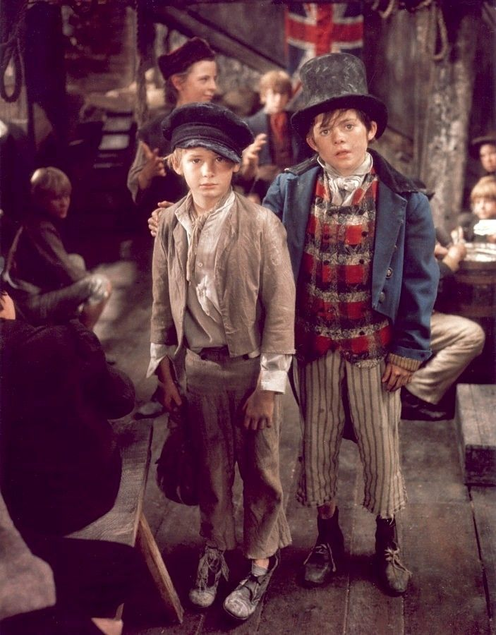 The Artful Dodger ( Jack Wild ) and Oliver Twist ( Mark Lester )