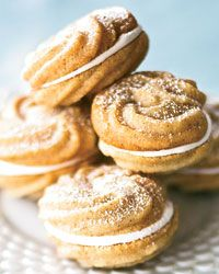 """Cinnamon Spritz Sandwich Cookies Recipe from Food & Wine...Spritz cookies are buttery Scandinavian sweets made by forcing (""""spritzing"""") dough through a press, creating fun shapes. Matt Lewis and Renato Poliafito's cakey version—piped with a pastry bag, then sandwiched with fluffy meringue—resembles a little whoopie pie."""