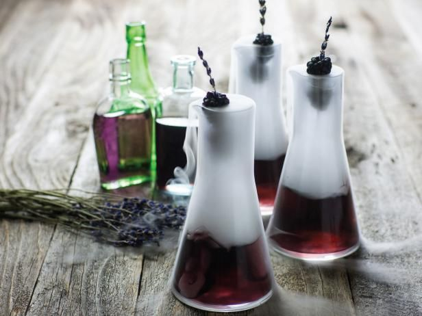 Lammas & Lughnassadh - Purple Cocktails in Beakers With Raspberry Skewers // Made with lavender, raspberries, and blackberries. Just remove the dry ice and this would actually be a great drink for Lammas.