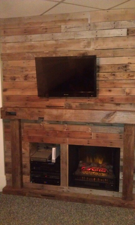Entertainment Wall Fireplace With Real Beam Mantel On An