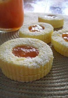 Biscotti con la confettura di pesche 250 g di farina 90 g di zucchero 100 g di…