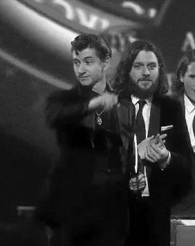 Alex dropping his microphone after his speech at the Brit awards c: