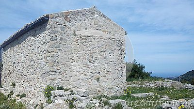 Rear view of stone Byzantine chapel at the summit of Angelocastro (Castle of the Angel), archaeological site of Byzantine castle on a hilltop overlooking Ionian Sea, Corfu, Greece.