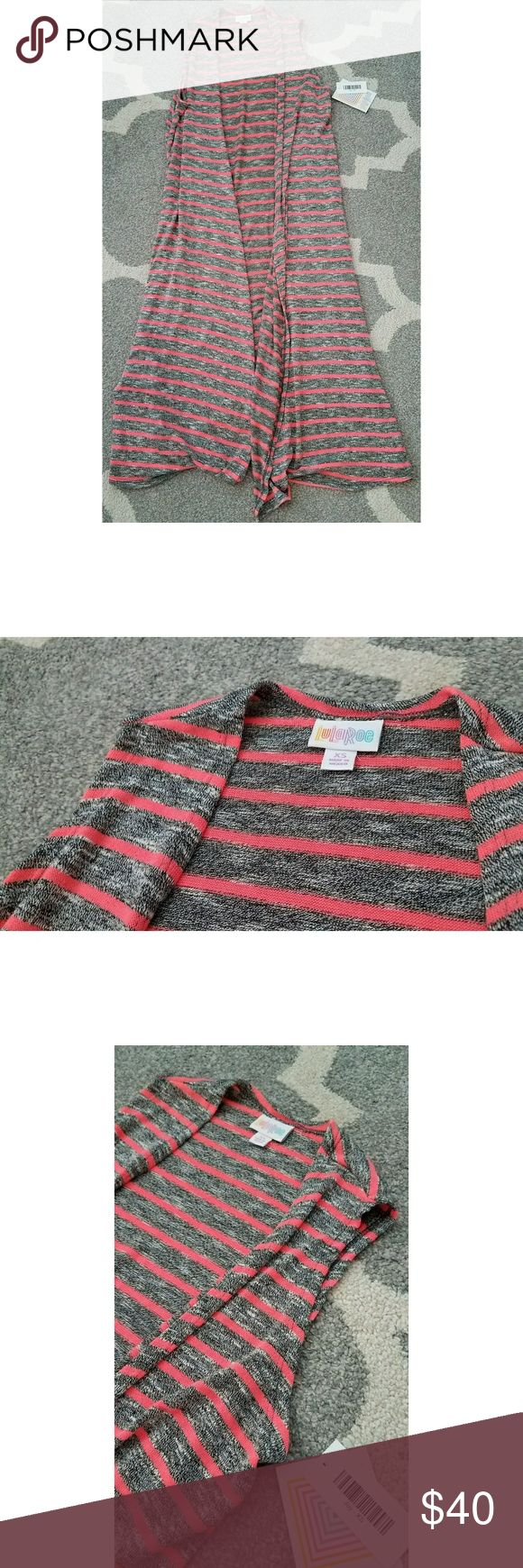 NWT XS Lularoe Joy duster sweater vest *NWT *XS *Duster sweater vest *Heathered black (kind of gray) w/ hot pink/coral colored stripes (color best reflected in pics 2, 3 & 4). *Intentional slits on the left & right sides of the sweater *Smoke & pet free home *Perfect with skinny jeans and/or bodycon dress & even shorts LuLaRoe Sweaters