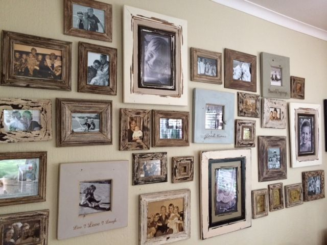 Revive old frame. Take dark wood frames, paint them any underlying colour you like. When dry, sand off selectively, use dark brown oil paint over the whole frame and wipe off with a dry cloth. It gives an antique look. All darker frames in this photo were painted with white paint. Put on a wall with a few newer frames in complimentary colours and filled with black and white images. Makes a lovely family wall.